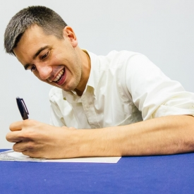 Justin Lamb signs one of his cds @ the UConn Co-op book tour launch. (Tom Kaszuba photo)