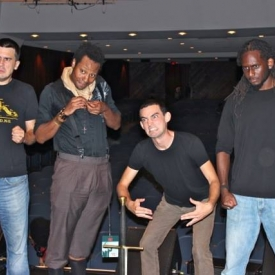 My son Justin (on the left) and his Team Slam New Orleans teammates perform one of their group poems that won them the national slam championship in Boston this summer.